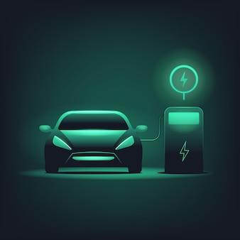 Auto elettrica con luce verde su sfondo scuro. stazione di ricarica per veicoli elettrici.