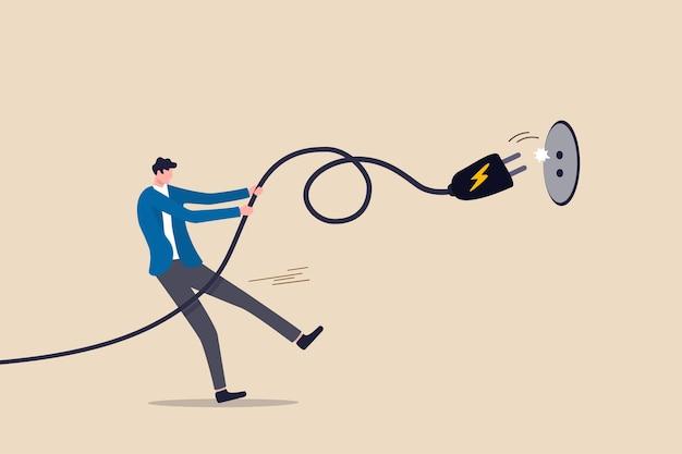 Risparmio di elettricità, consapevolezza dell'ecologia o riduzione dei costi elettrici e concetto di spesa, uomo che tira il cavo elettrico per scollegare per risparmiare denaro o per l'energia ecologica.