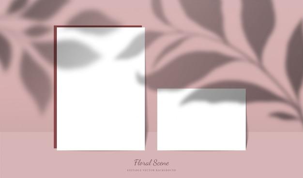Mockup di carte eleganti con ombre floreali sovrapposte. scena di carta di cancelleria vuota modificabile con sfondo di fiori