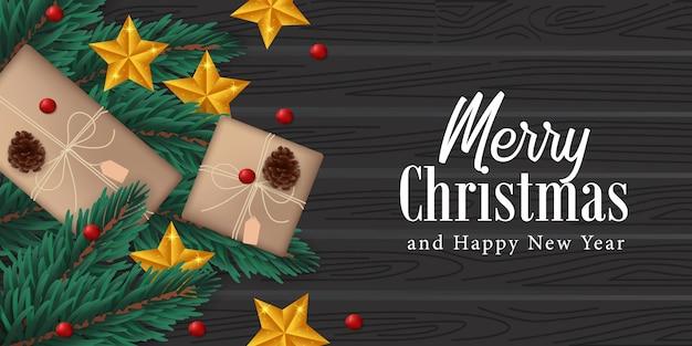 Elegante decorazione realistica ghirlanda di foglie di abete, pigna, stella dorata, scatola presente sul legno nero per natale Vettore Premium