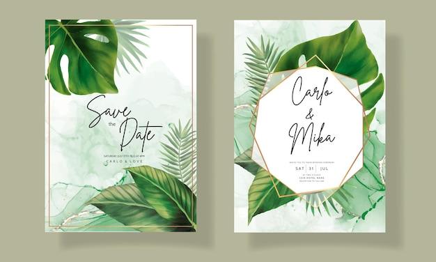 Elegante carta di invito a nozze con foglie tropicali verdi acquerello