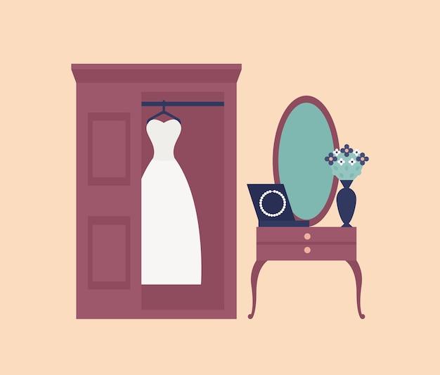 Elegante abito da sposa bianco o abito appeso nell'armadio, specchio a parete e toletta con perline o collana su di esso