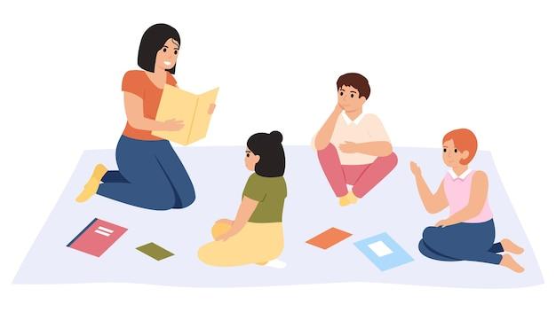 Lezione di scuola elementare. libro di lettura femminile dell'insegnante di scuola materna all'illustrazione del gruppo dei bambini