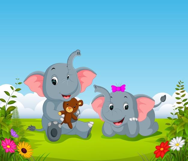 Carrello dell'orso della tenuta della coppia dell'elefante
