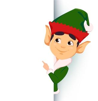 Elfo in piedi dietro un cartello e mostrando sul cartello bianco Vettore Premium