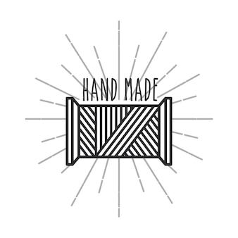 Emblema del concetto fatto a mano con l'icona di bobina di filo