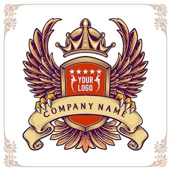 Emblema con ali, corona e nastro. distintivo elegante e brutale per le imprese