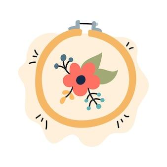 Ricamo di un fiore con piante su un'illustrazione vettoriale di telaio da ricamo in stile piatto
