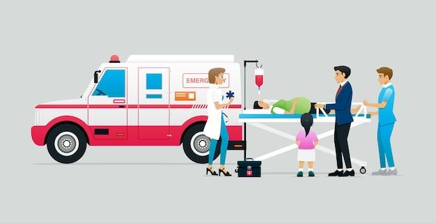 Veicolo di emergenza con un medico per prendere una donna incinta per un parto prematuro