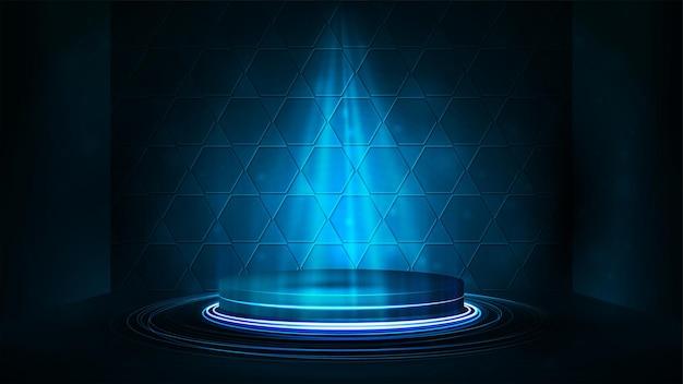 Podio blu vuoto con illuminazione di faretti e sfondo a nido d'ape. scena digitale blu per la presentazione del prodotto