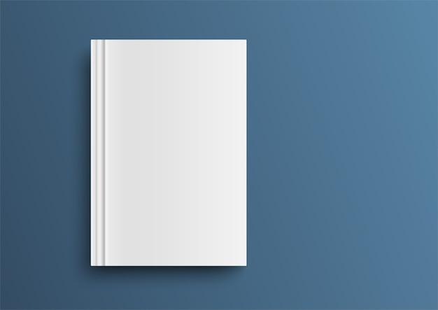Copertina di libro vuota sul tavolo blu