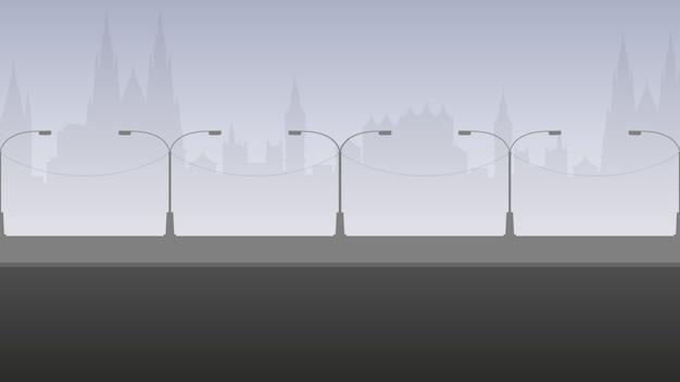 Strada vuota con silhouette della città. paesaggio della città in colori grigio chiaro. .