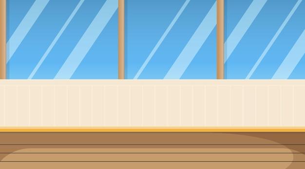Stanza vuota con pavimento in parquet e finestre scorrevoli sul patio