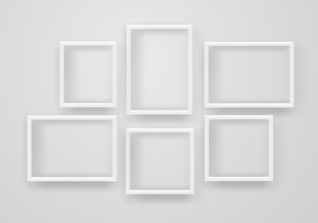 Cornici bianche vuote su una parete
