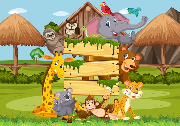 Tavola di legno vuota con vari animali selvatici nella foresta