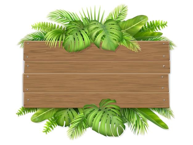 Cartello in legno vuoto decorato con foglie tropicali.