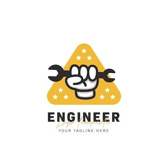 Logo della lotta per la libertà dello spirito dell'ingegnere, illustrazione dell'icona del logo dello strumento della chiave inglese della mano del pugno dell'ingegnere