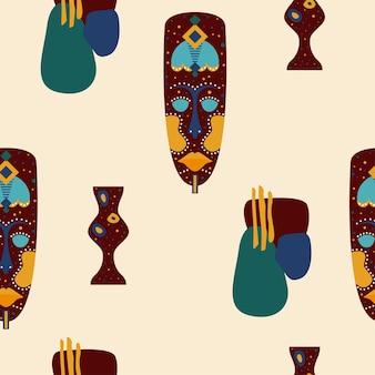 Modello senza cuciture etnico maschera africana. simboli tribali tradizionali africani.