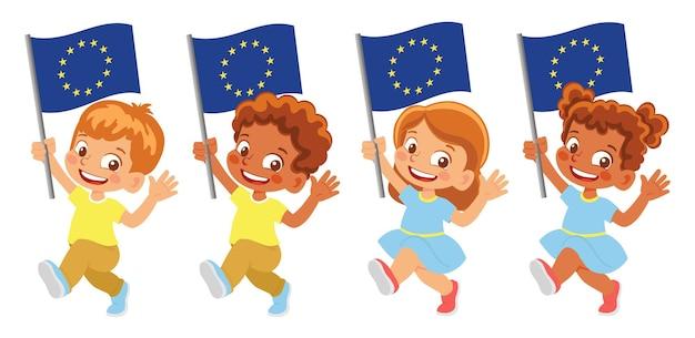 Bandiera dell'ue in mano. bambini che tengono bandiera. bandiera dell'europa