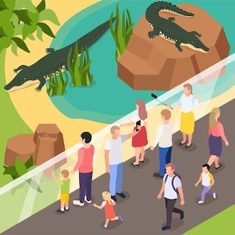 Animali esotici nell'illustrazione isometrica dello zoo con i visitatori che fanno selfie con due coccodrilli nello stagno