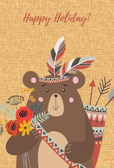 Faccia l'orso tribale con bouquet di fiori, piume e frecce