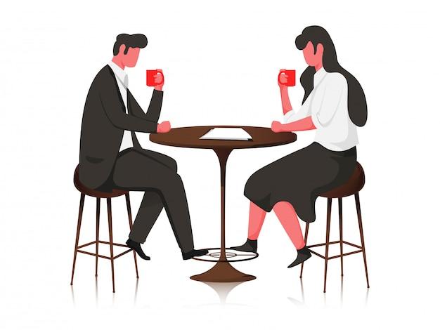 Coppia giovane senza volto, bere caffè o tè al tavolo del bar.