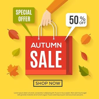 Design del poster di vendita autunnale con borsa della spesa e foglie d'autunno