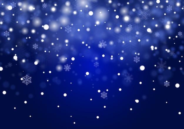 Neve che cade. fiocchi di neve cadere realistici isolati su sfondo trasparente. forti nevicate in diverse forme e forme. posto per il testo su sfondo blu
