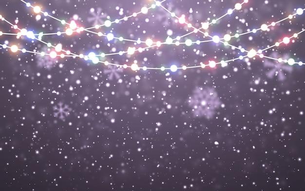 Fiocchi di neve cadenti bianchi su sfondo scuro