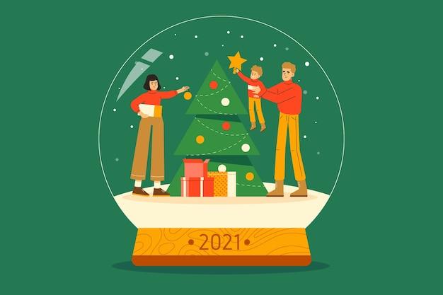 Famiglia che decora l'albero di natale insieme nel globo della neve per celebrare le vacanze di capodanno