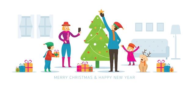 Famiglia che decora un albero di natale