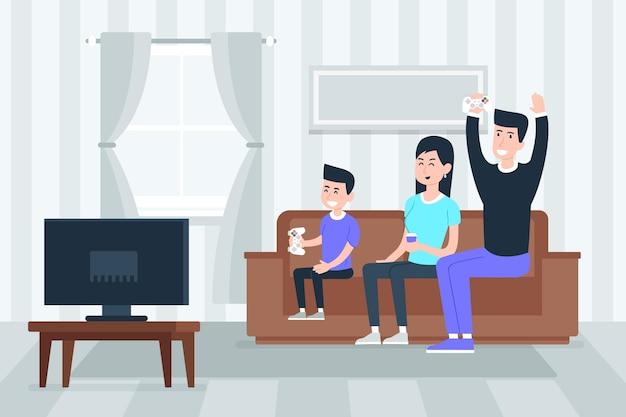 Famiglia che gode del tempo insieme a guardare la tv