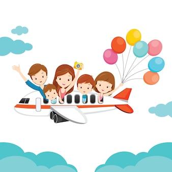 Famiglia felice in aereo, viaggio con la famiglia felicemente insieme