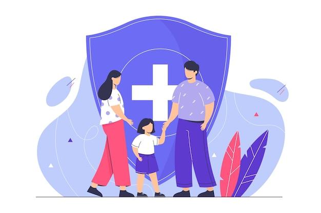Concetto di assicurazione sulla vita familiare con giovani genitori e bambini