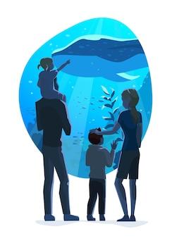 La famiglia guarda il mondo sottomarino nell'illustrazione piatta dell'oceanarium