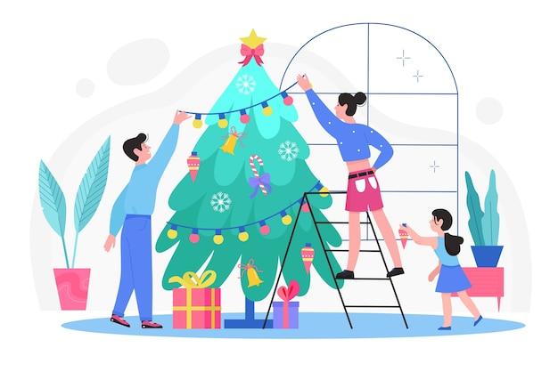 La gente della famiglia che decora l'albero di abete di natale nel soggiorno di casa insieme