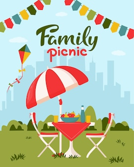 Concetto di picnic in famiglia con tavolo servito