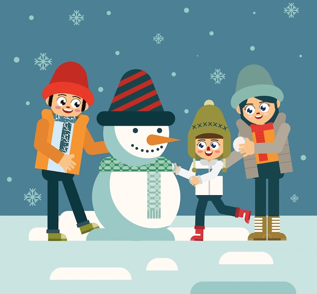 Famiglia che gioca pupazzo di neve nella notte di inverno