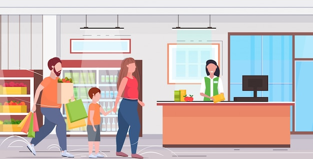 Acquisto della famiglia nel supermercato sovrappeso padre madre e figlio che pagano per l'acquisto alla cassa orizzontale interna piana della drogheria della cassa