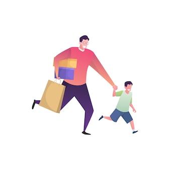 La famiglia che compera con il padre porta un pacco e suo figlio