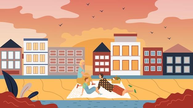 Famiglia tempo concetto. le persone hanno un picnic sul paesaggio urbano. padre, madre e figlio si divertono, comunicano, godono della splendida vista del paesaggio urbano e del tramonto.