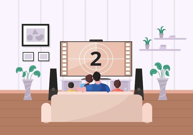 Famiglia che guarda un film seduto sul divano nel soggiorno di casa
