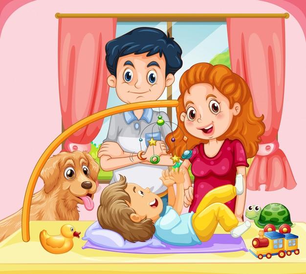 Famiglia con piccolo bambino che gioca giocattolo mobile