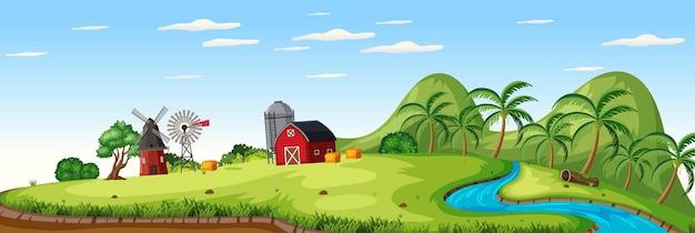 Paesaggio dell'azienda agricola con fienile rosso e mulino a vento nella stagione estiva