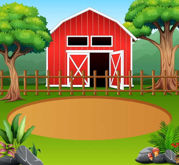 Paesaggio agricolo con tettoia rossa in mezzo alla natura