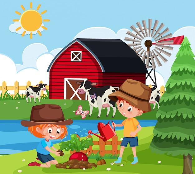 Coltivi la scena con i bambini che piantano gli alberi sull'azienda agricola