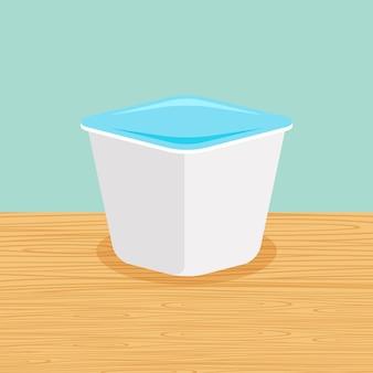 Mangia lo yogurt sul tavolo