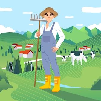 Carattere del contadino in piedi mentre si tiene una forchetta di paglia e l'erba verde con le mucche al pascolo