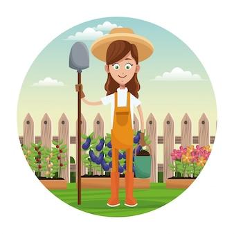 Recinto del giardino della pala del cappello di paglia della ragazza dell'agricoltore