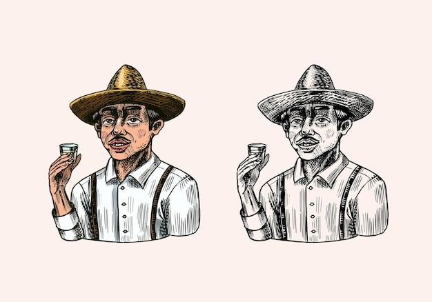 Coltivatore che tiene un colpo di tequila.